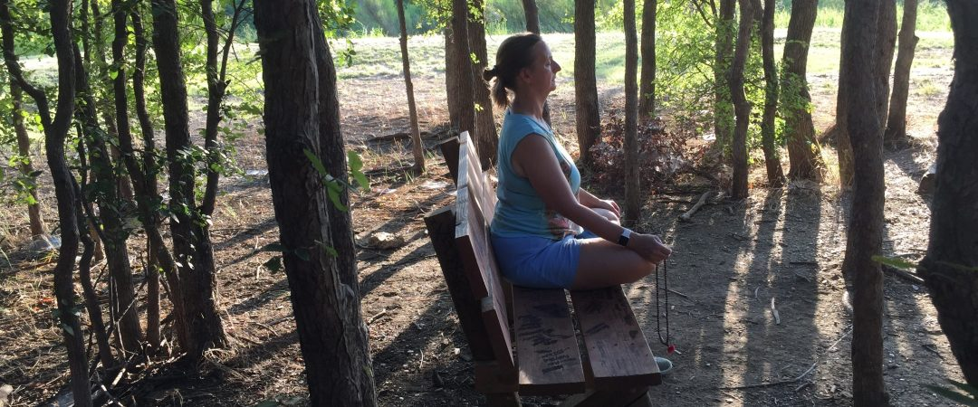 Terri meditating on Bench